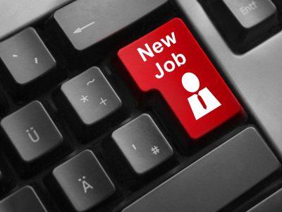 dark grey keyboard red enter button new job emoployee symbol